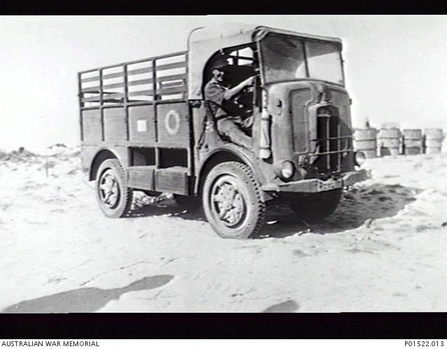 SIDI BARRANI, EGYPT. BILL CRAIGIE OF 2-2ND FIELD WORKSHOP, AT THE WHEEL OF A SPA CLF39 TRUCK, ONE OF THE FIRST CAPTURED ITALIAN VEHICLES. (Small).jpg
