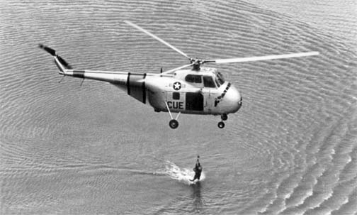 USAF H-19 helicopter, 3rd Air Rescue Group, hoists an unidentified airman aboard from Far East waters, 1953.jpg
