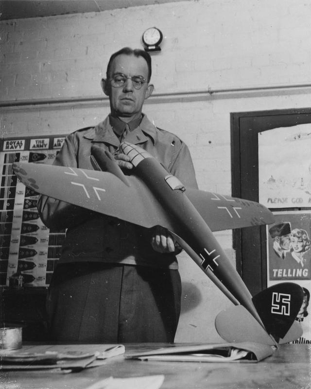 Captain Jesse Marshall Barrett, of the 303rd Bomb Group, inspects a model of a Heinkel HE 111.jpg