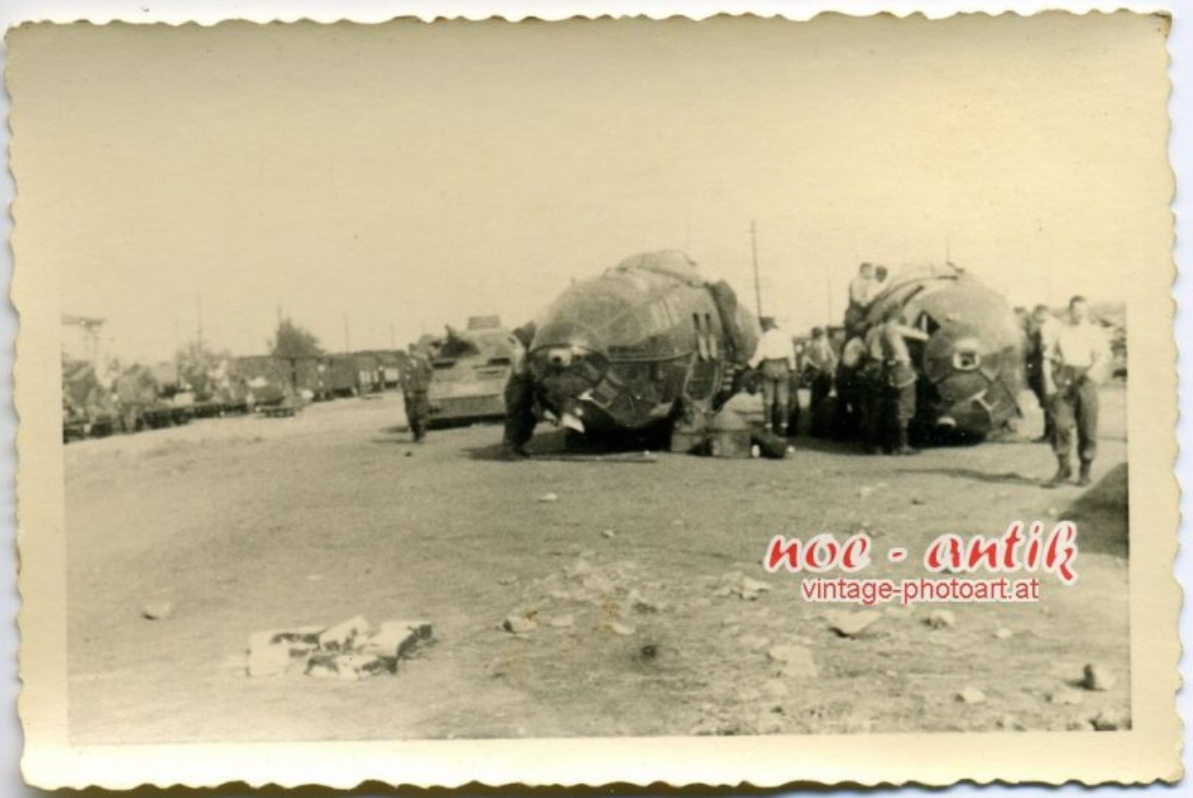 9. Two He111 fuselages at a Russian train station awating salvage.jpg