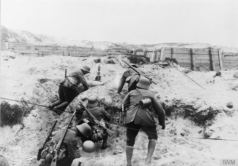 27.9 A German minenwerfer  section in action in the dunes on the Flanders.jpg