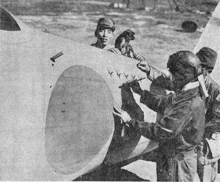 A Japanese pilot marking a victory on his A6M Zero fighter%2C 14 Feb 1942%3B note his unit%27s mascot%2C a monkey%2C on the aircraft.jpg