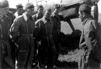Slovak pilots listening to a Luftwaffe flight instructor as they are schooled for flying on German Messerschmitt planes in Denmark..jpg