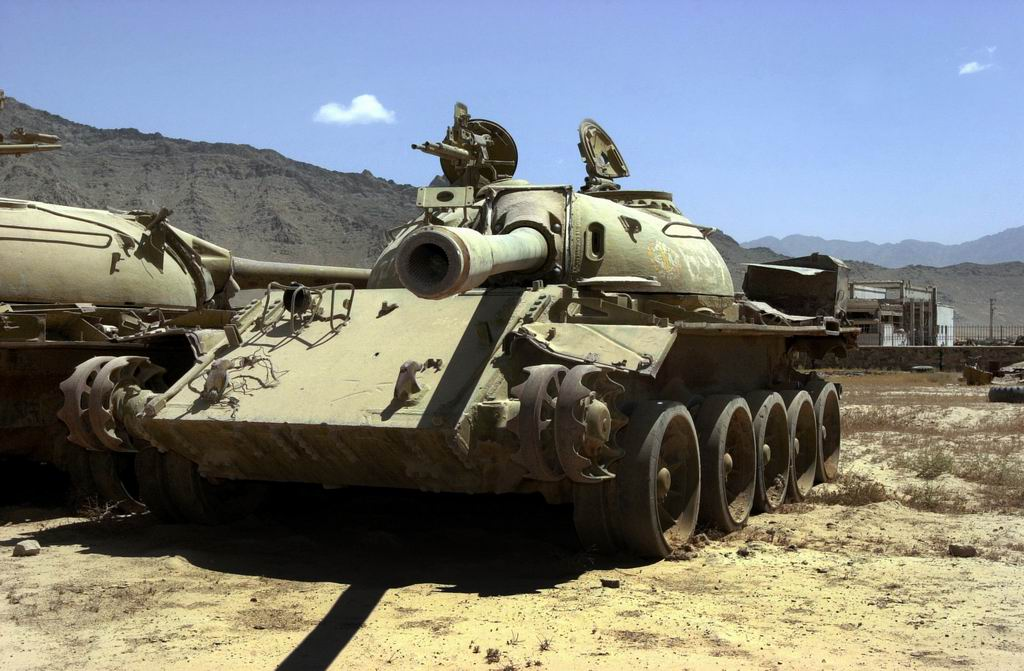 Two_Soviet_T-55s_sit_rusting_near_Bagram_Air_Base,_Afghanistan.JPEG