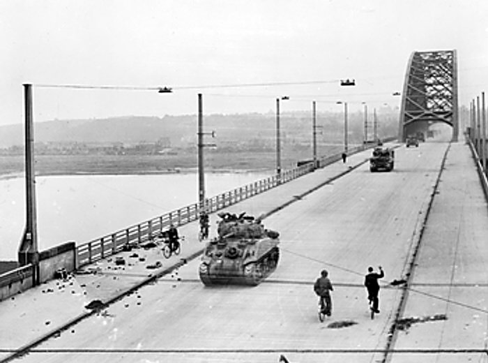 British_XXX_Corps_cross_the_road_bridge_at_Nijmegen_.jpg