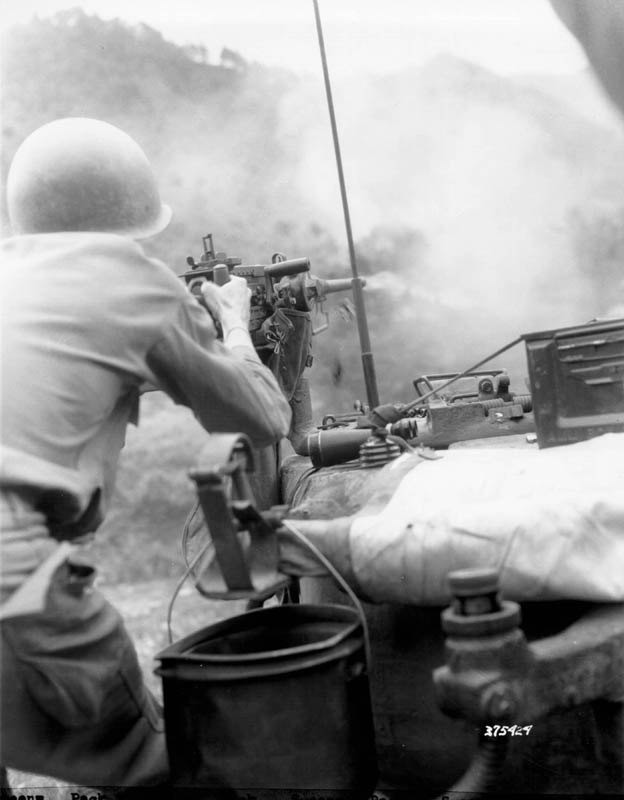 Tanker fires 50 cal MG at Red Chinese, Korea, 14 Jul 51.jpg