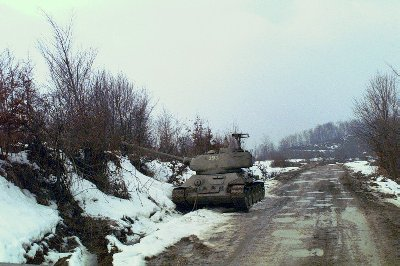 Serbian T-34 tank is parked on the edge of the road beside a snow-covered bank during Operation Joint Endeavor.jpg