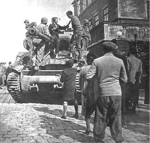 US ARMY Sherman Tank crew being received by the the people of czech city of Pielsen, wich they liberate in april, 1945..jpg
