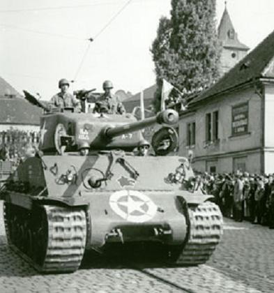 US Army Sherman Tank entering in the Czech city of Pilsen, in april 1945, WWII.jpg