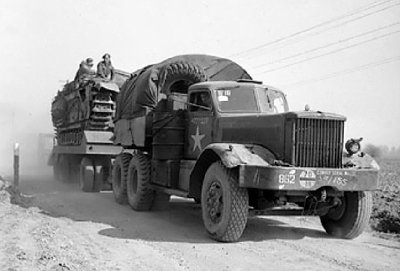 British Army Diamond T Model 980 tractor towing a trailer loaded with a Churchill tank during preparations for crossing the Rhine River into Germany, 23 Mar 1945..jpg