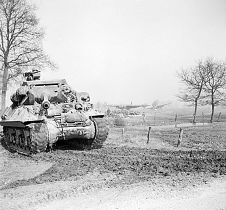 British Achilles tank destroyer on the east bank of the Rhine River, 26 Mar 1945; note abandoned gliders in background..jpg
