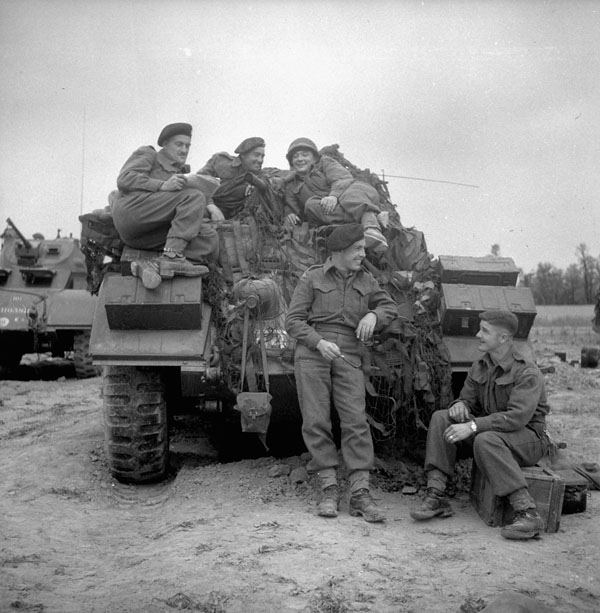 Troopers of the 12th Manitoba Dragoons with a Sherman tank of a Canadian armoured regiment..jpg