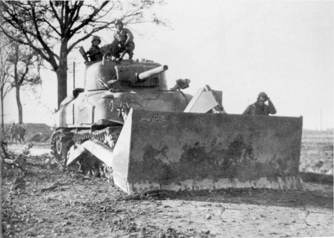 An-M4A1-bulldozer-from-Co-I-66th-Armd-Regt-2nd-AD-clears-a-road-during-Roer-River-offensive-on-19-November-1944.jpg