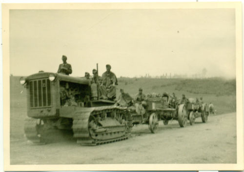S-65 captured Russian tractor towing a 15cm sFH18.jpg
