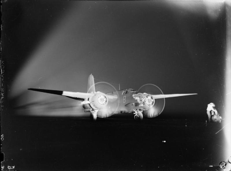 Illuminated by a Chance Light by the runway at Bradwell Bay, Essex, a Douglas Boston Mark III (Intruder) of No 418 Squadron.jpg
