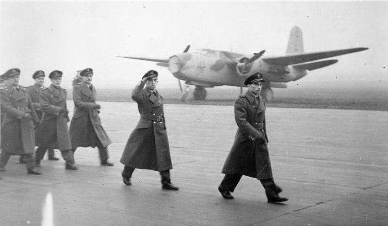 Polish personnel march past at the salute at an airfield in the United Kingdom; possibly No. 307 (Polish) Squadron RAF at.jpg