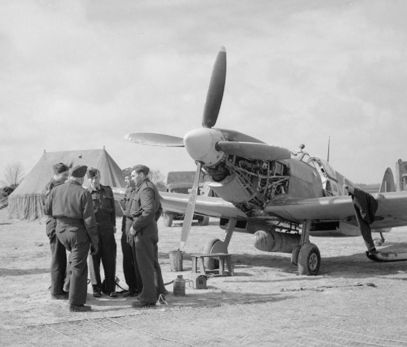 A Spitfire LF IX of No 313 Squadron undergoing an oil change at Appledram ALG (advanced landing ground), near Tangmere, 19 April 1944. Many fight squadrons were operating from temporary.jpg