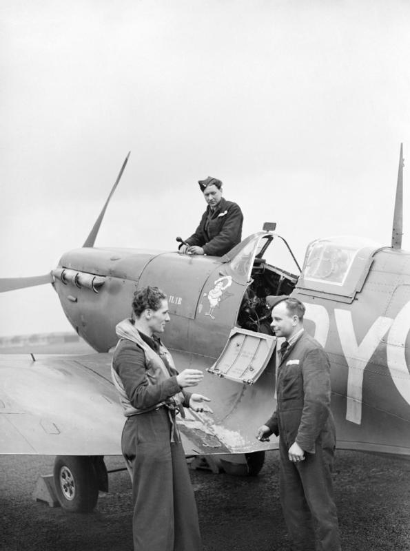 A Czech Spitfire pilot of No 313 Squadron in conversation with his rigger and fitter at Hornchurch, 8 April 1942. His aircraft is BL581 Moesi-llir, a Mk VB presented by the Netherlands East Indies Fund.jpg
