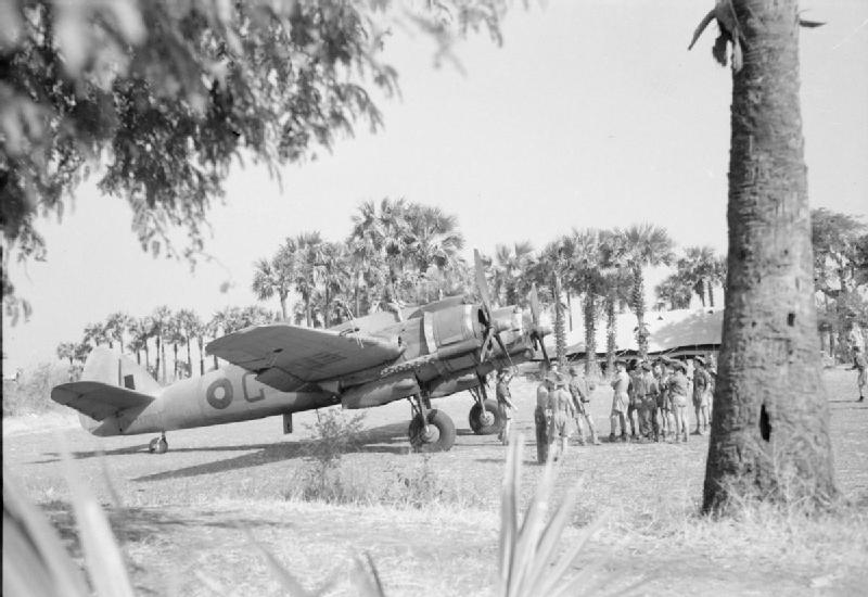 Groundcrew surround the pilot of Bristol Beaufighter Mark VIF, X7898 'G', of No. 89 Squadron RAF Detachment at Sadaung, Burma, after a sortie over the Mandalay area..jpg