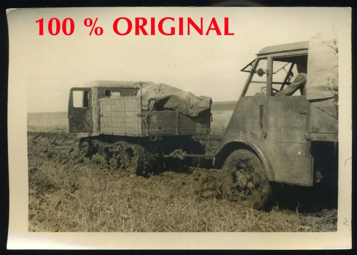STZ-5 captured Russian tractor towing a Renault truck of 597. Jäger Div. in Russian mud.jpg