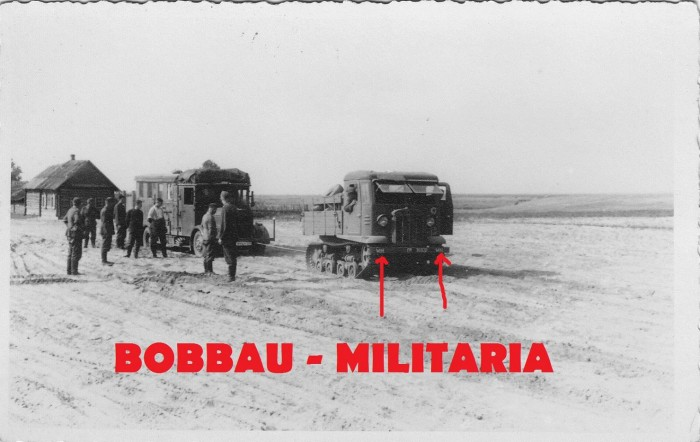STZ-5 captured Russian tractor in german service towing a truck-.JPG