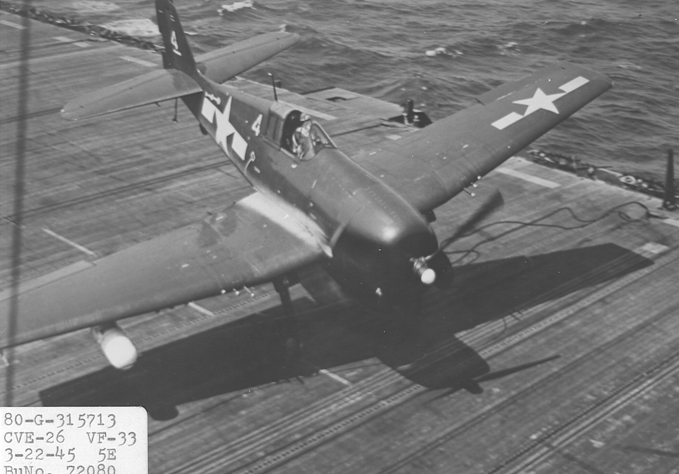 F6F-5E_VF-33 is on the deck of the USS Sangamon.jpg