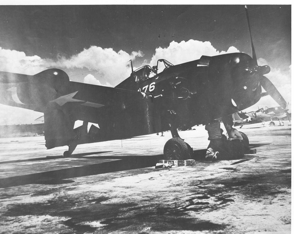 F6F-5N_VMF-511 being worked on on the ground.jpg