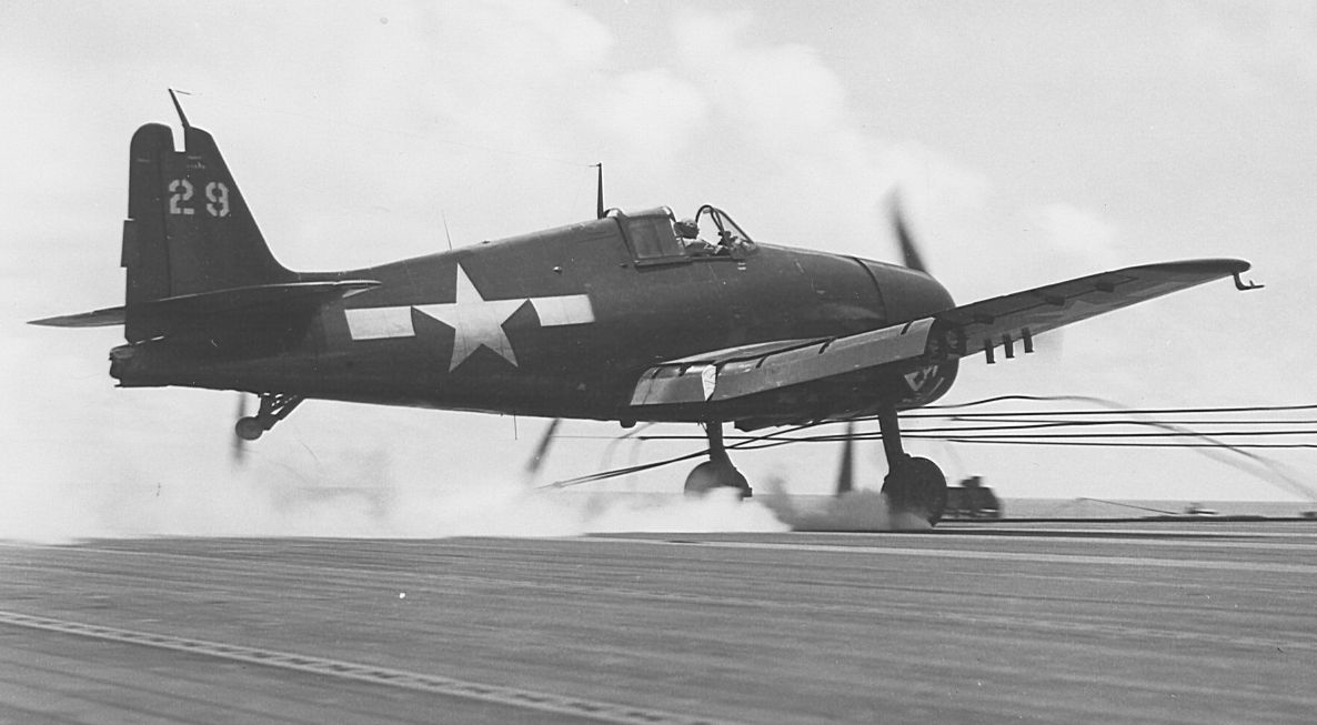 F6F-5N_VMF-512 lands fighting cables, barriers, on the flight deck of USS Gilbert Islands.jpg