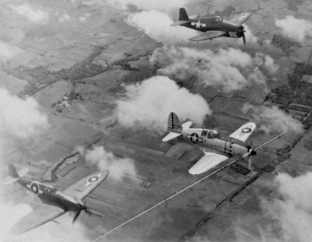 Captured_J2M_with_F6F_and_Seafire_1945.jpg