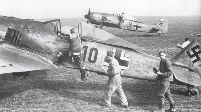 Fw 190A-3-U4s Red 9 W.Nr. 35 346 and Red 10 W.Nr. 35 327, or might be 35 397 - of 2.F123 at St. Pol in March 1943..jpg