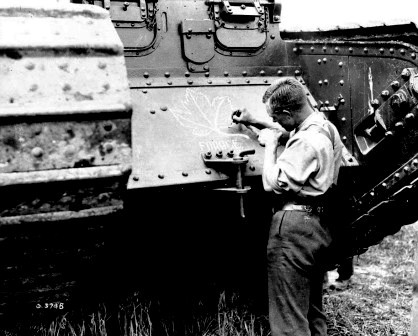 Painting_a_Maple_leaf_on_a_British_Great_War_Tank.jpg